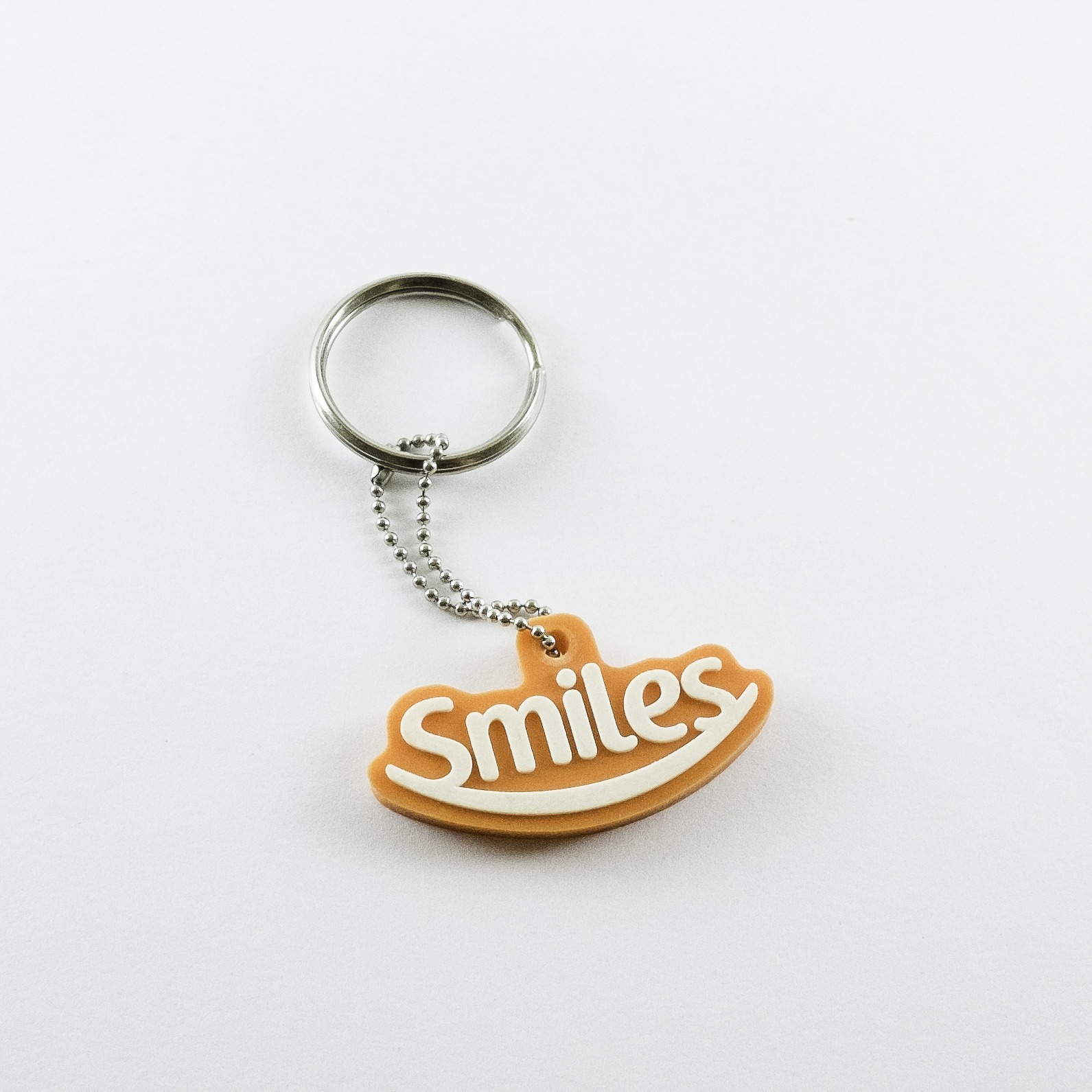 chaveiro emborrachado smiles relevo